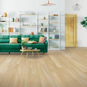 Green couch on floor | Everlast Floors
