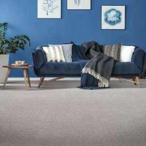 Stylish effect with carpet and blue couch | Everlast Floors