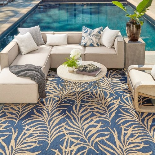 Area rug near swimming pool | Everlast Floors